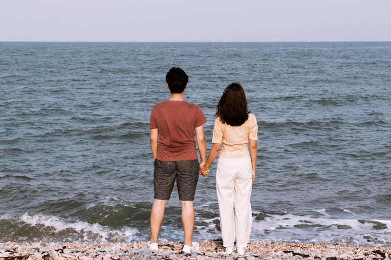 Man and Women hand in hand on a beach